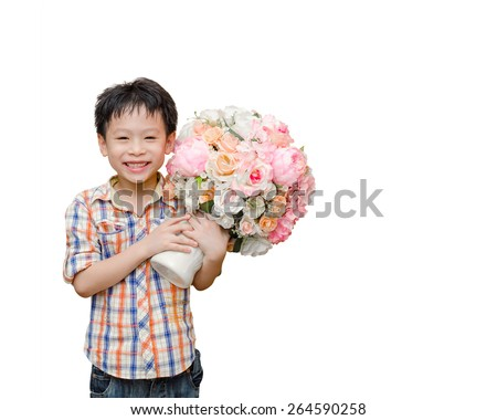Little Asian boy holding flower for his mother over white