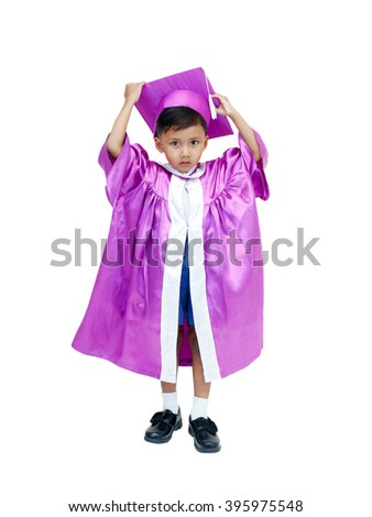 little asian boy in graduation gown . - stock photo