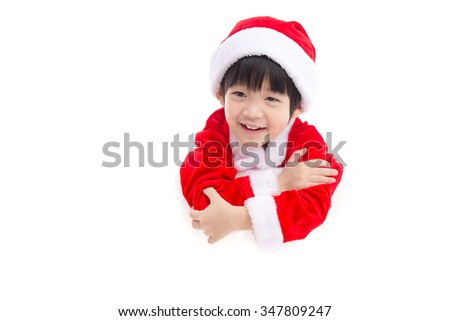 Little asian boy  in Santa Claus  uniform with an empty banner, isolated on white
