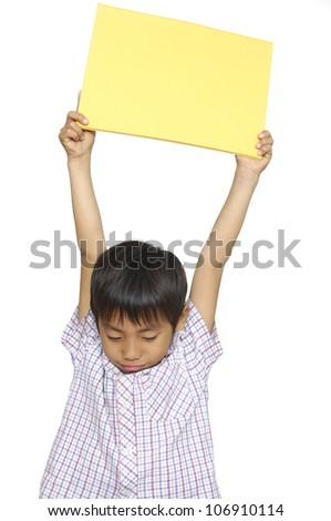 Little asian boy in school uniform holding a blank billboard - stock photo