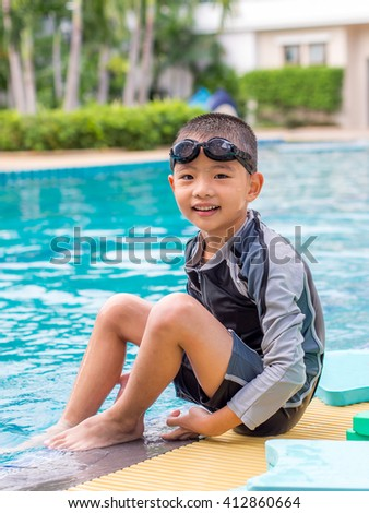 little asian boy in swimming suit with goggles - stock photo
