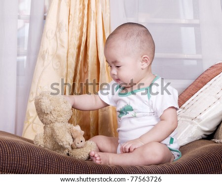 little asian boy playing with toy