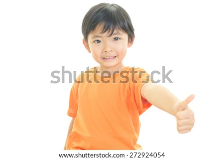 Little Asian boy showing thumbs up sign