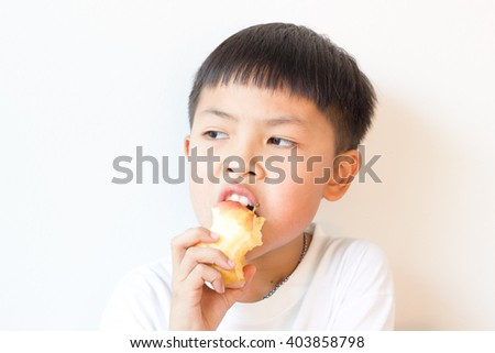 little asian boy with  apple isolated on white background
