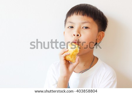 little asian boy with  apple isolated on white background  - stock photo