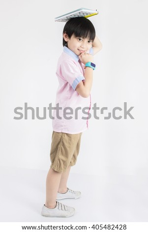 Little asian boy with book on head thinking, Education concept. - stock photo