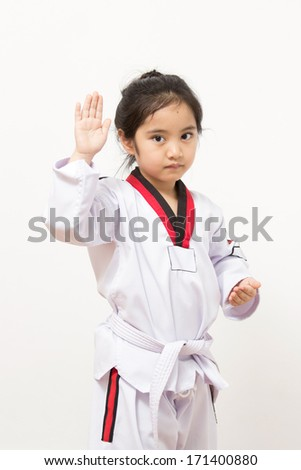 Little asian child in fighting action on isolated background