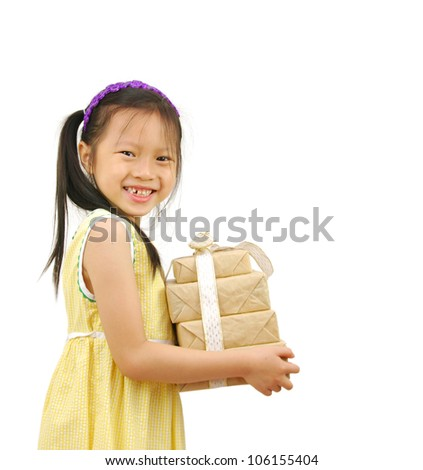 Little Asian girl arms out holding a beautiful wrapped present - stock photo