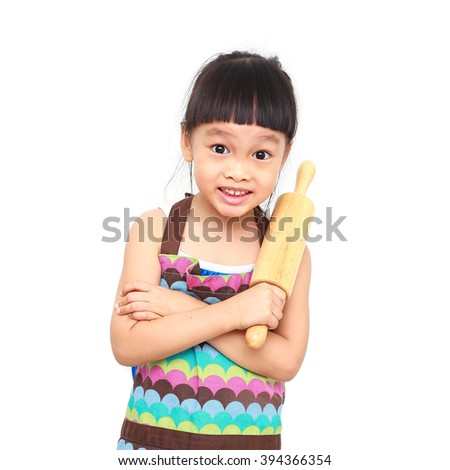little asian girl chef cooking with colorful apron  on white background