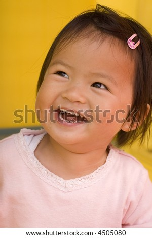 little asian girl having fun - stock photo