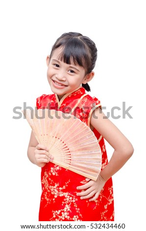 Little Asian girl in chinese traditional dress holding fan