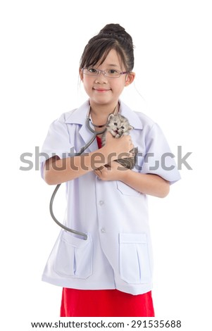 Little asian girl playing veterinarian with kitten on white background isolated