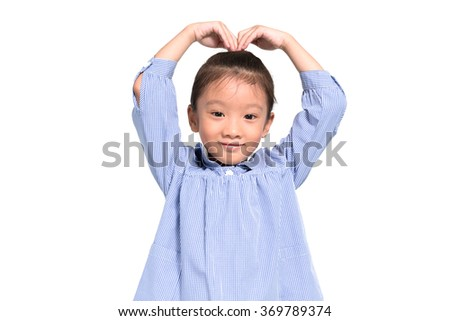 Little asian girl posing lovely and happy with isolate white background