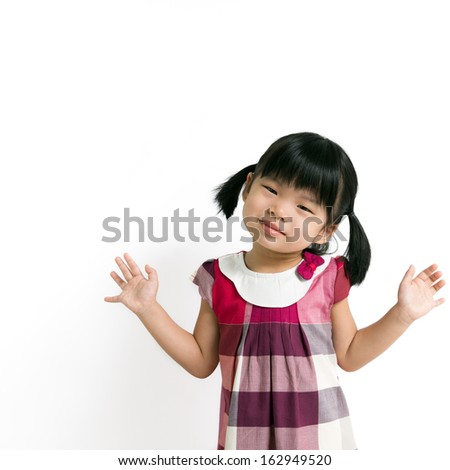 Little asian girl posing with her hands up in the air stock photo