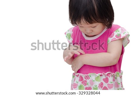 Little Asian girl scratching mosquito bite sore - stock photo