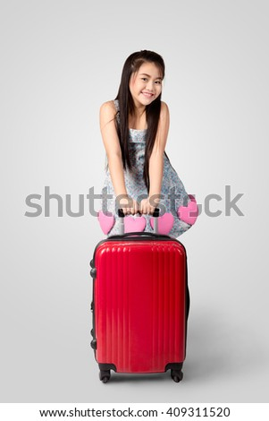 Little asian girl standing with the suitcase Isolated on grey background, Travel or vacation concept - stock photo