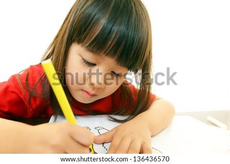 Little Asian girl Studying - stock photo