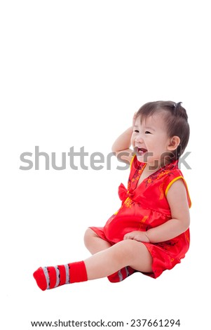 Little asian girl (thai) in traditional chinese dress, cheongsam is typical china dress, identity culture of Chinese New Year festival. Isolated on white background