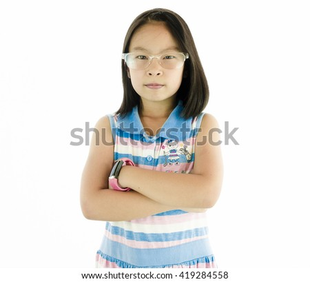 little asian girl thinking or dreaming-cross one's arm - stock photo