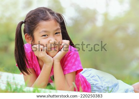 Little asian girl was playing happily in the park