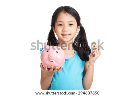 Little asian girl  with a coin and piggy bank  isolated on white background
