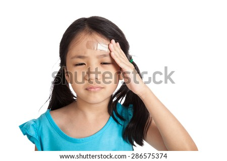 Little asian girl  with bandage on forehead  isolated on white background