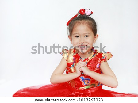 Little Asian girl with Congratulation gesture isolated on white background. Happy chinese new year.