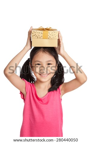 Little asian girl with gift box over her head  isolated on white background - stock photo