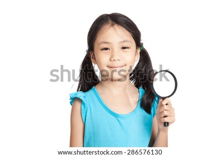 Little asian girl with magnifying glass  isolated on white background