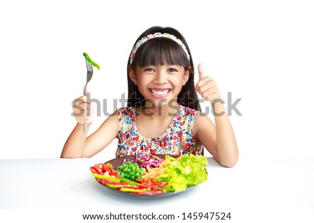 Little asian girl with vegetables food, Isolated over white - stock photo