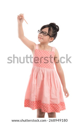 Little asian girl writing on white background isolated - stock photo
