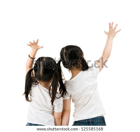 Little asian girls raising their hands, isolated on white background