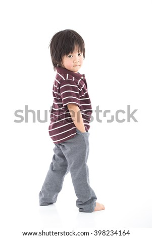 Little asian preschool boy standing isolated on white background