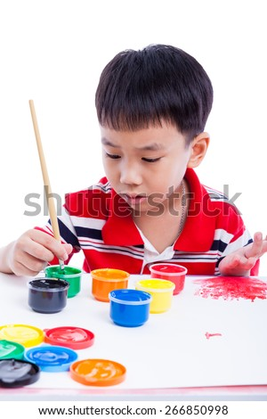 Little asian (thai) boy draw image using multicolored drawing instruments (watercolor paints, paintbrush), creativity concept, isolated on white background, studio shot - stock photo