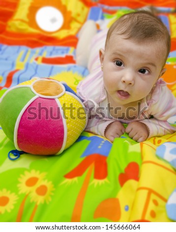 little baby and ball. - stock photo