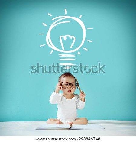 "Little baby and blackboard with ""Light Bulbs"" on background, School concept - stock photo"