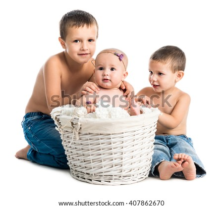 little baby and two brothers together isolated on white background