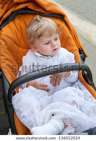 Little baby boy being baptized in white christening gown clothes - stock photo