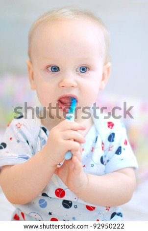 little baby boy brushing teeth
