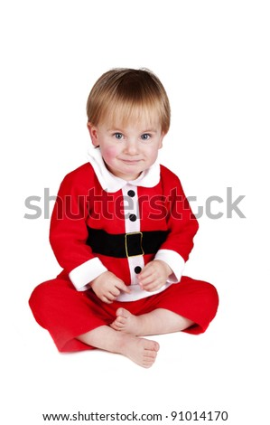 Little baby boy dressed up as Santa Claus for Christmas