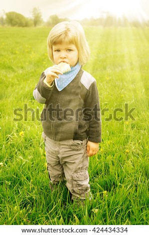 Little baby boy has allergies from flower meadow. Allergy season concept. - stock photo