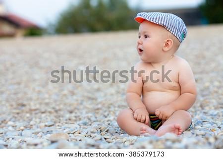 Little baby boy in swimming trunks sitting on beach pebbles  sc 1 st  Shutterstock & Little Baby Boy Swimming Trunks Sitting Stock Photo (Royalty Free ...