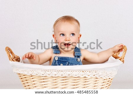 Little baby boy inside the wicker basket