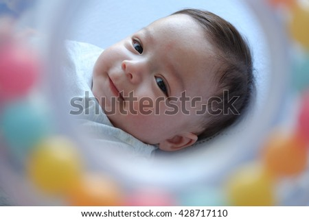Little baby boy smile when see the toy. - stock photo