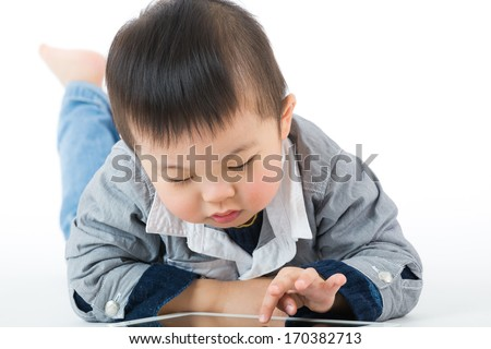Little baby boy using tablet