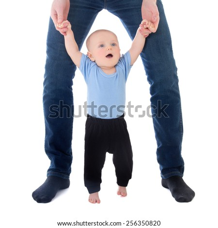 little baby boy walking with father isolated on white background - stock photo