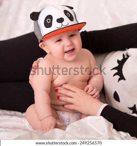 Little baby boy wearing a panda cap. - stock photo