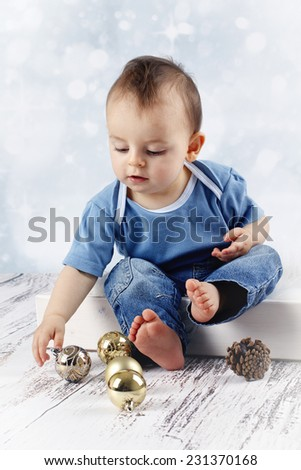 Little baby boy with christmas balls - stock photo
