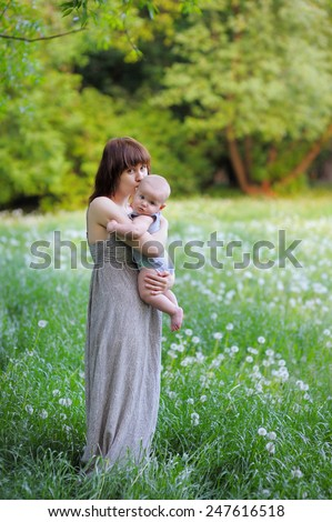 Little baby boy with her young mother  - stock photo
