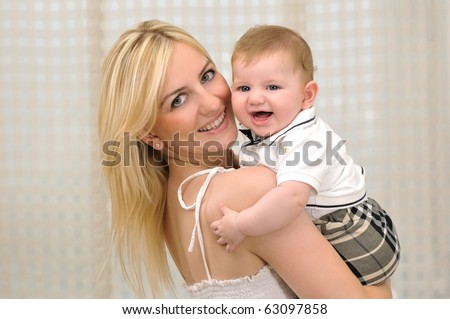 Little baby boy with his mother - a series of FAMILY images. - stock photo